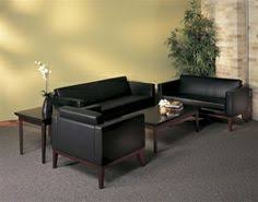 this stylish waiting area features a black leather lounge furniture set from the mayline prestige collection black leather sofa office