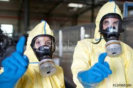 Hazmat Removal Workers Warning Of Toxic Waste Buy This Stock Photo