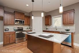 wood kitchen cabinets with river white granite