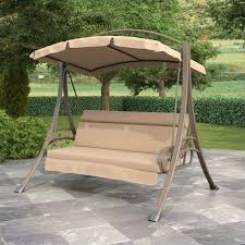 patio swing with arched canopy in beige