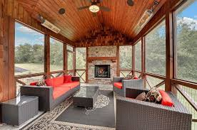 ... Rustic sunroom with a splash of red and gray [Design: Mark D. Williams