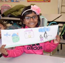 garden city park school kindergartner lillian abraham colored a pictured at the ymca after school program