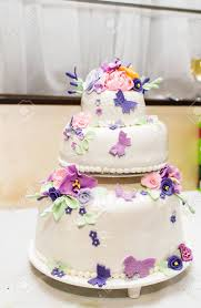 White Wedding Cake With Sugar Butterflies And Flowers Stock Photo