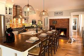 view in gallery traditional brick fireplace serves both the kitchen and the breakfast zone design open meadow