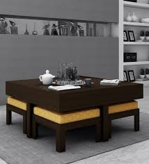 trendy coffee table with 4 stools