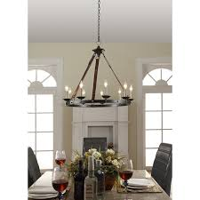 brass chandelier justice design lighting above small marble dining table and two black leather chiars in front of white fireplace