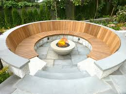 stone and wood circle this fire pit and create a warm atmosphere perfect for catching up with old friends