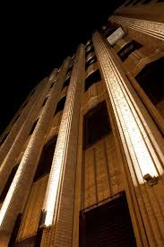 building facade lighting. The Walker Tower In New York Was Converted From Office Space To A High-end Apartment Building. Detailed Art Deco Façade And Spires Are Illuminated. Building Facade Lighting 0