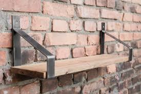 image of shelf hanging on a brick wall