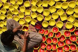 an n craftsman paints clay diyas earthen lamps ahead of  the guardian 17 homely and peaceful celebrations lost as fireworks replace oil lamps in s hindu festival of lights