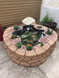 above ground pond using garden wall blocks patio fish raised lowe s ponds do it yourself