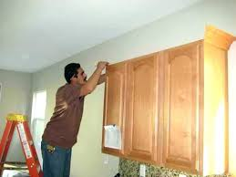 how to put crown moulding on kitchen cabinets how to install crown molding on kitchen cabinets