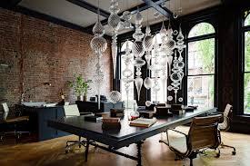 interior design heritage office renovation workspace exposed brick black chandelier