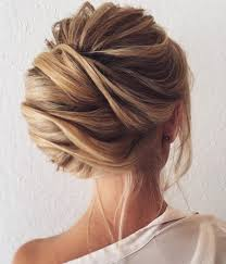 situate your french twist off to the side to put a fun new spin on this clic updo loose tendrils help to make this look soft and cal meaning you can