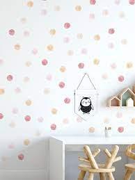 muted pink watercolor polka dots wall