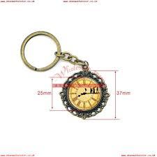 wzk0115 20pcs lot vintage peter pan clock keychain art pendant glass dome cabochon key ring diy handmade jewelry