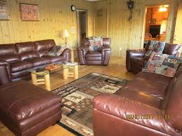 living room is furnished with 2 sets of leather furniture