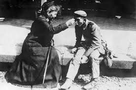 the red cross during war photo essays time first world war a german red cross nurse helps a destitute man