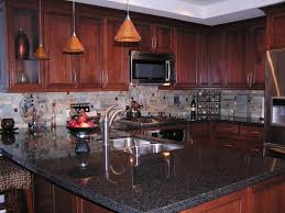image of granite countertops with dark cabinets