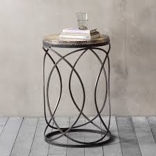 metal based side table with a linked circle design and hammered gold metal top