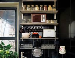When you're short on cupboard space, a combination of wall-mounted racks  with smart cabinet organizers can make a tiny kitchen more functional.