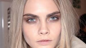 subsuting brown for black instantly makes a smoky eye more subtle just keep the shadow close to your lid the gorgeous look from burberry is a great