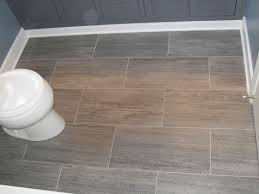 flooring ideas for small bathrooms. big rectangle tile flooring with white toilet above. fabulous bathroom ideas for small bathrooms offer fascinating look o