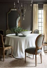this matte dark gray dining room offers a moody grace and sophistication for the daring