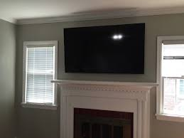 tv mounted above unwired brick fireplace solid brick behind plaster wall power and components