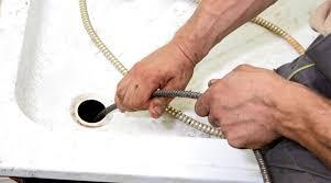plumbers venice fl. Wonderful Plumbers Plumber Snaking A Drain Intended Plumbers Venice Fl E