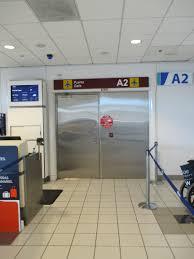 inside door. File:Puerto Rico \u2014 San Juan Luis Muñoz Marín International Airport (inside Door To Gate A2 For Employees).JPG Inside