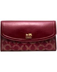 COACH - Madison Dotted Op Art Checkbook Wallet - Lyst