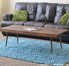 This diy coffee table is so simple, but requires some skills to create. Remodelaholic Diy Modern Slat Coffee Table Building Plan