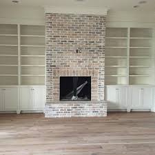 brick fireplace and built ins with shiplap