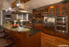 kitchen accent lighting. Contemporary Upscale Home Kitchen Interior With Wood Cabinets And Floors, Granite Countertop, Accent Lighting