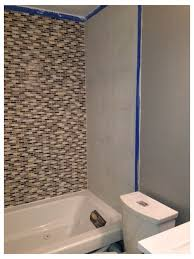 frameless glass shower doors or a shower curtain i feel if we have all that tile a curtain is going to cover it or compete with it