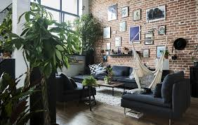 a living room with high ceilings brick wall and grey modular sofa home visit ideas