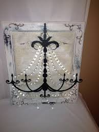 metal chandelier wall art in white black and a little blue