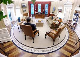 obamas oval office. President Obama Reads Briefing Material In The Oval Office At White House. Obamas W