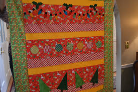 Pots and Pins, Creativity, Quilts, DIY Projects, Grandbabies, Parties & This was the last quilt Terry showed us - another cute Christmas quilt...I  love the Christmas lights that are machine appliqued onto the quilt! Adamdwight.com