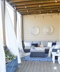 outdoor curtains on back porch bue and white outdoor living