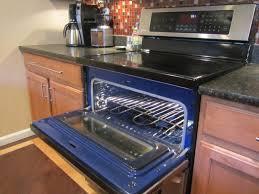 open oven in kitchen. kitchen remodel - double oven open door in n