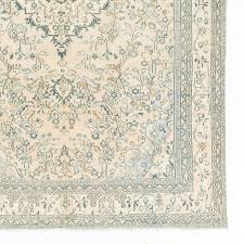 turkish vintage oushak area rug in soft aqua blue teal rust and cream colors