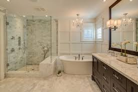 traditional tile bathroom bathroom traditional with framed mirror double sink crystal chandelier
