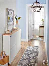 A slim hallway doesn't have to become a blank space that functions only for  foot traffic. Add a skinny console table, like this tilt-out unit, ...