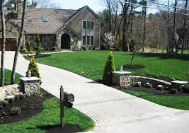 concrete driveways with stone gate posts