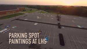 lebanon high school recently held a fundraiser in which students could paint their parking spots at