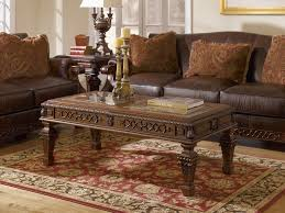 stylish tribal red rugs under gorgeous classic coffeetable and extraordinary ashley furniture toledo living room