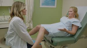Woman at the gynecologist photo