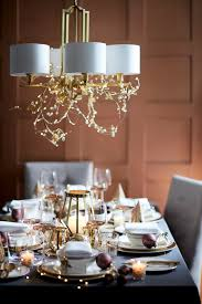 extend your styling around the dining table by d lightweight decorations from the ceiling not only will this create a beautiful focal point but it